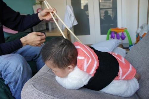 Baby dressed up as salmon sashimi