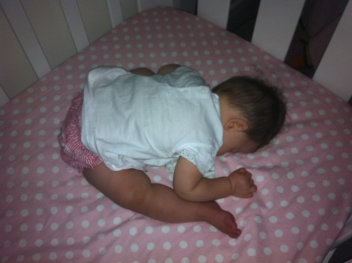 Arddun falls asleep in cot