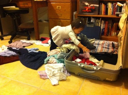 Arddun unpacking our suitcase.