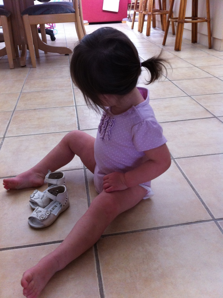 Arddun in a ponytail, waiting to put on her white sandals