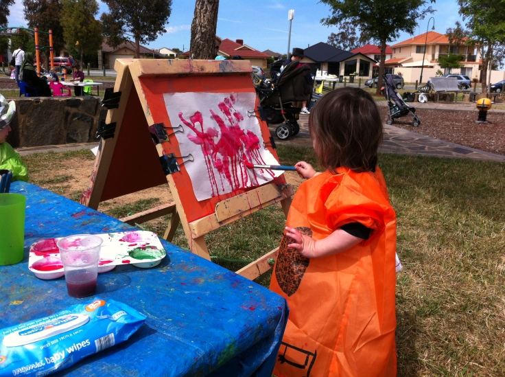 Arddun painting in the park with red watercolours