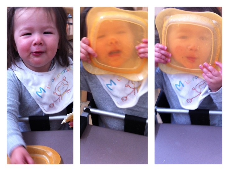 Arddun smooshes her face against her plastic plate for laughs.