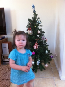 Arddun standing in front of Christmas tree