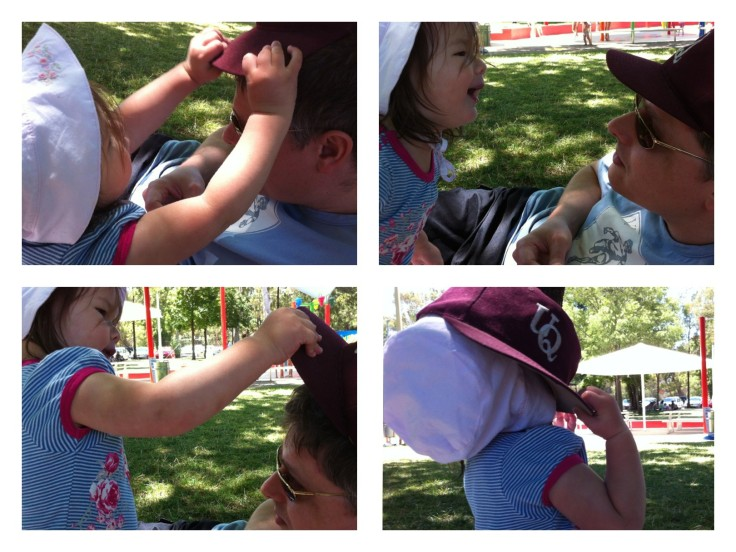Horsing around with Daddy's hat after our picnic lunch