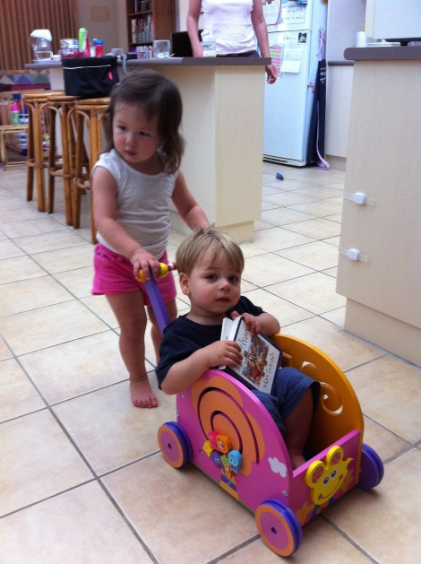 Arddun pushing Alex in wagon