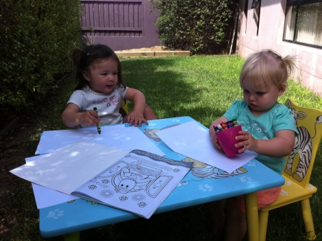 Charlie and Arddun drawing in the garden