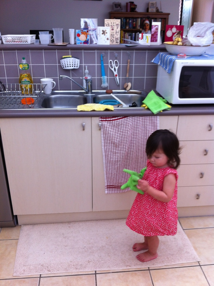 Arddun wears green washing-up glove