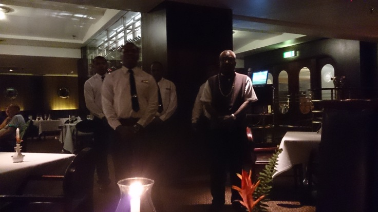 Singing waiters farewelling us