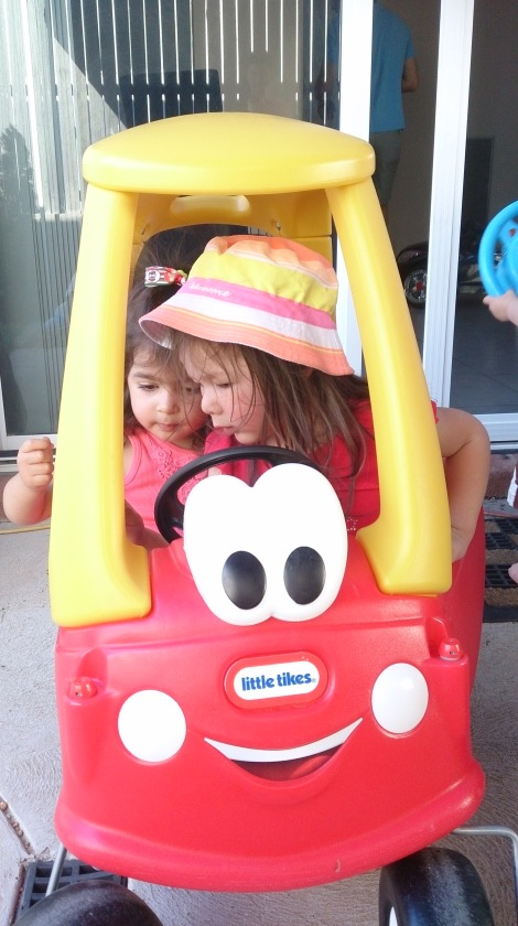Leila and Arddun squeeze into little red car