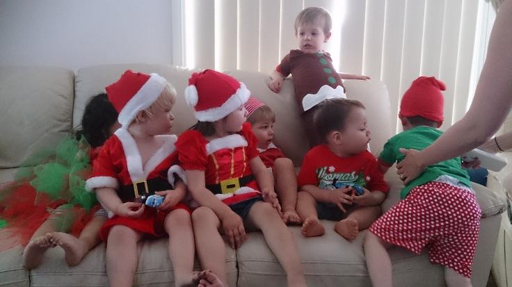 Christmas outfits on sofa, take 1