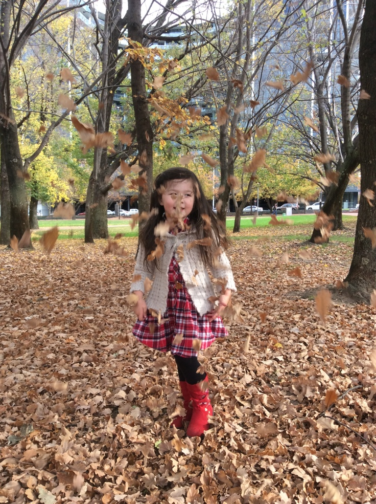 Arddun twirling in falling autumn leaves