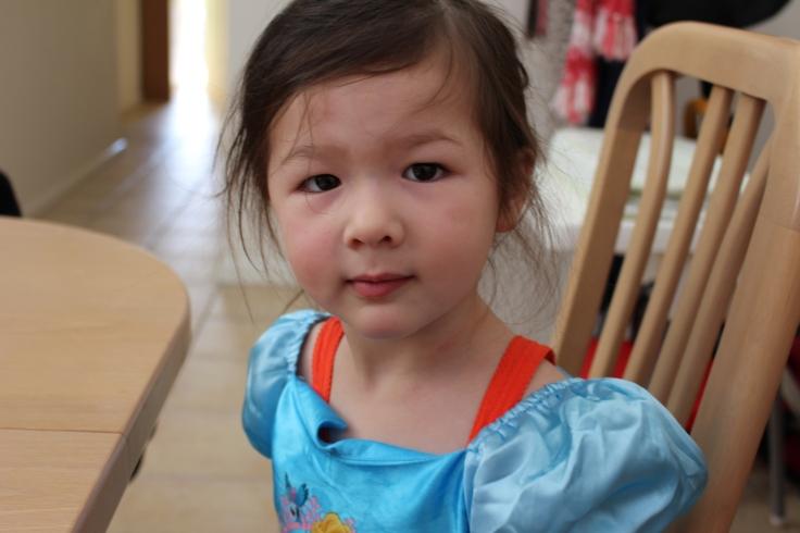 Arddun looking straight into camera, wearing Cinderella dress