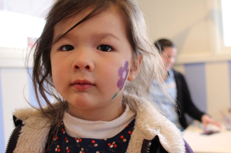 Arddun with face painted with flower on cheek