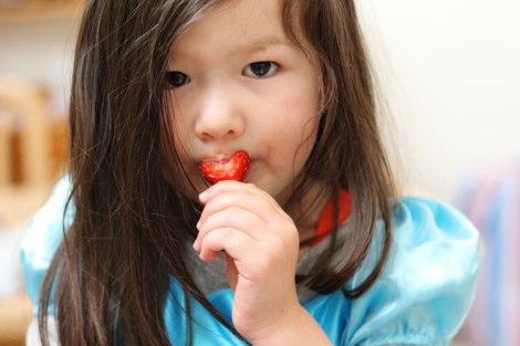 Arddun eating a strawberry