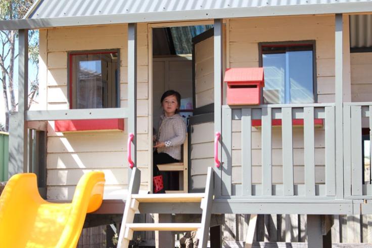Arddun sitting inside cubby house