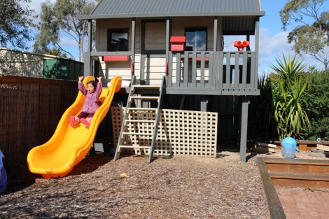 Leila sliding down from cubby house