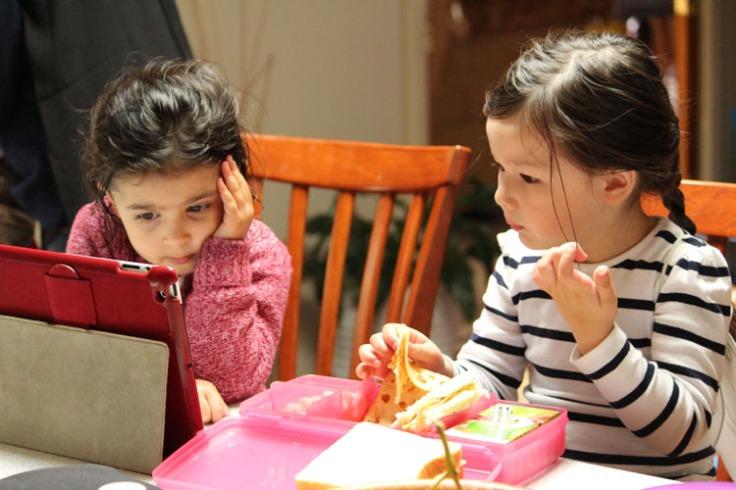 Arddun and Leila watching iPad