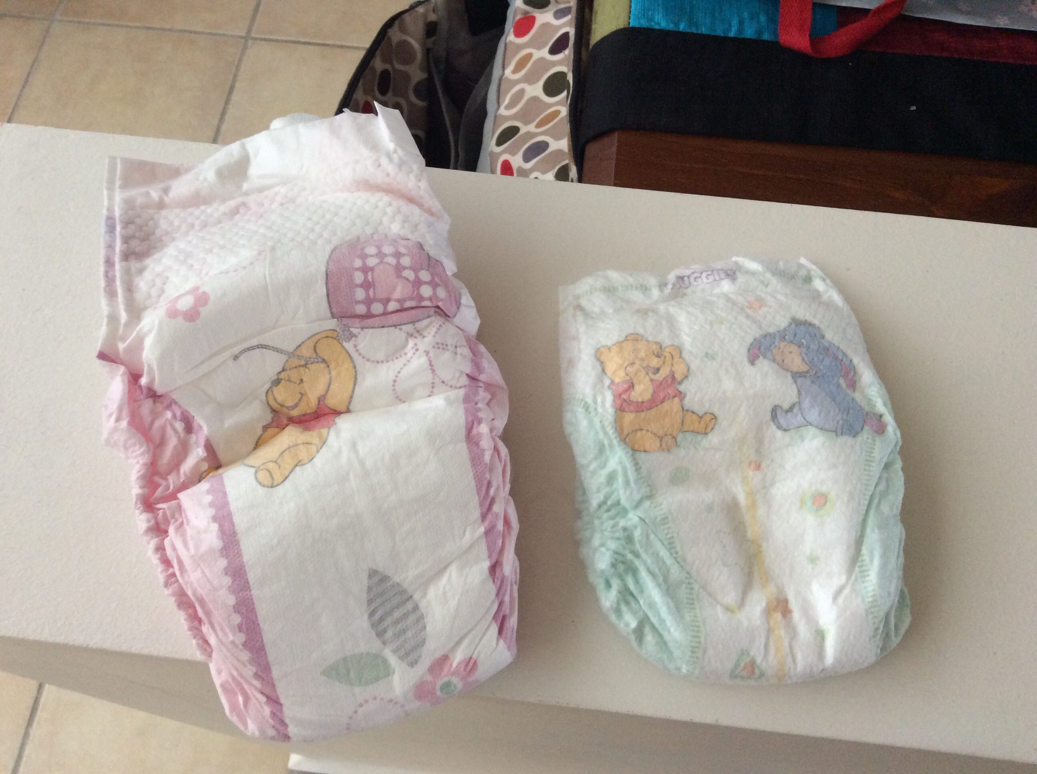 Comparing newborn diaper to Junior girls's diaper