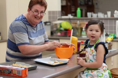 Nanna and Arddun posing for camera in mid-bake