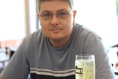 Tony with long glass of beer