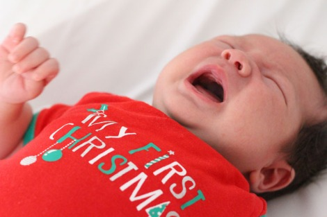 Atticus crying while wearing Christmas onesie 2014