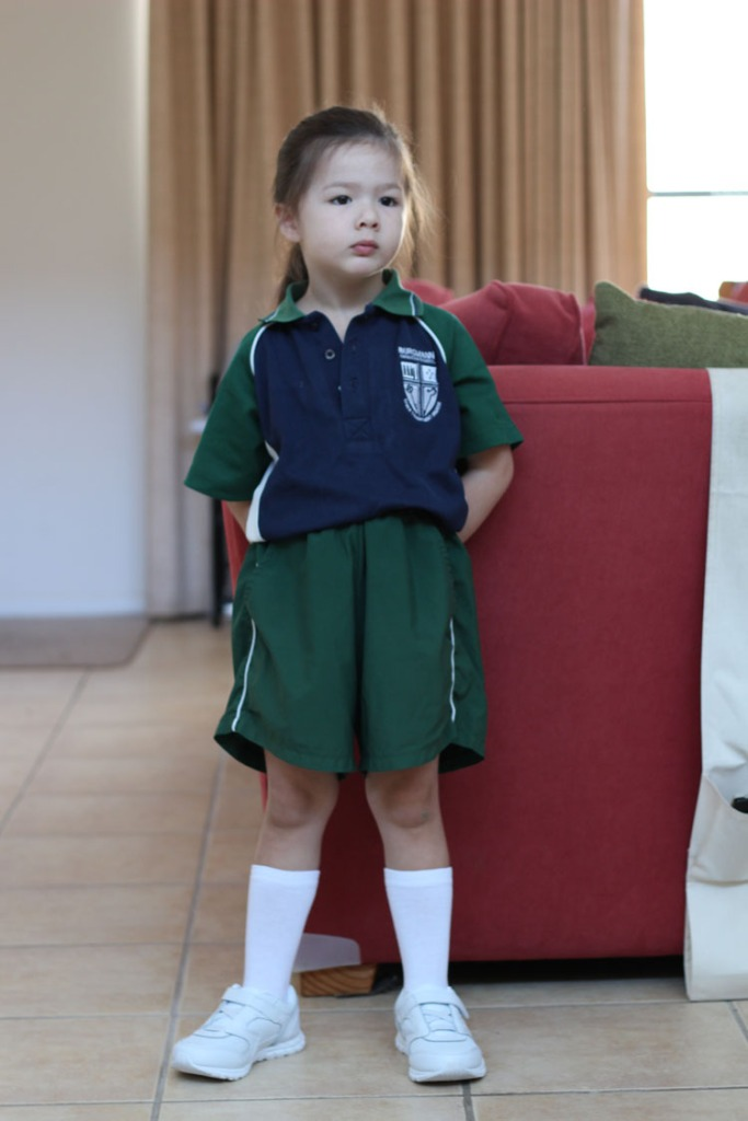 Arddun in school uniform at home full shot