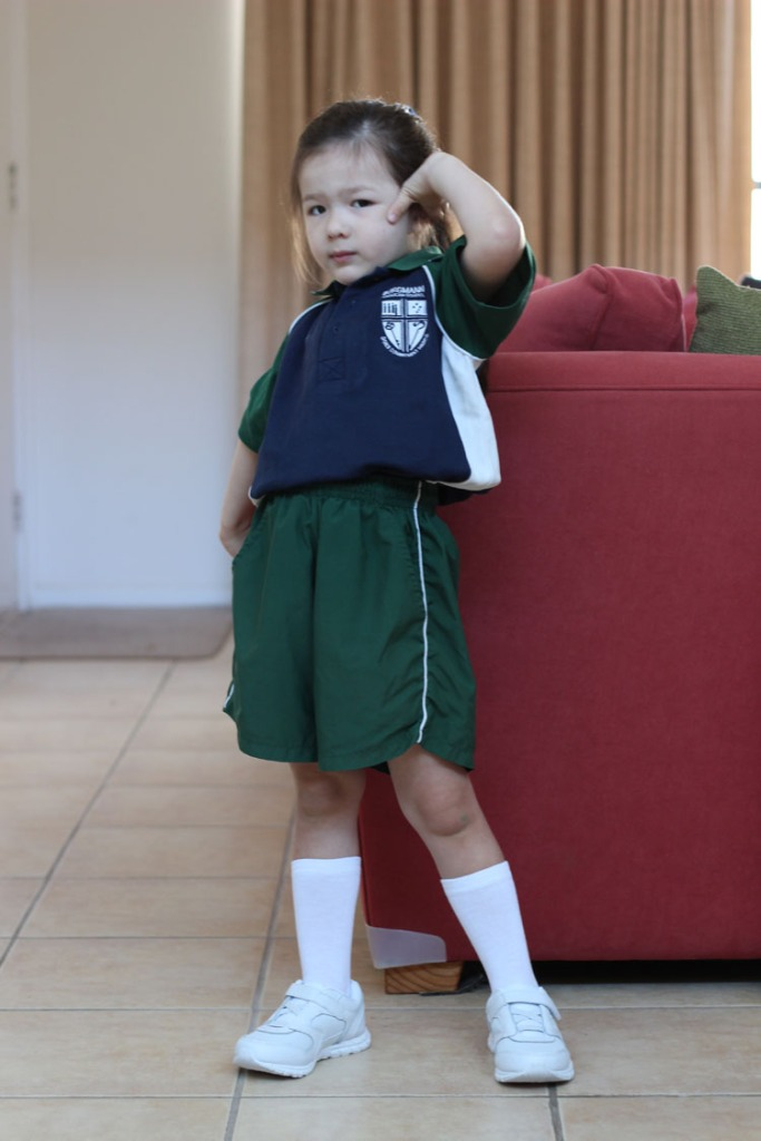 Arddun posing in house with uniform