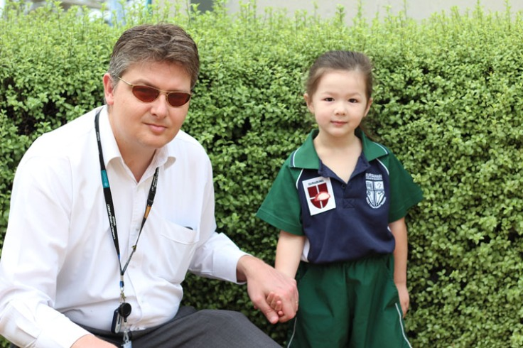 Arddun posing with Tony in school uniform