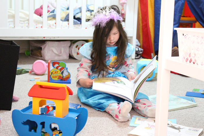 Cinderella reading in her room