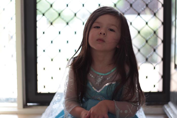 Elsa sitting by the door