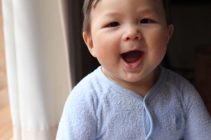 Atticus smiling widely