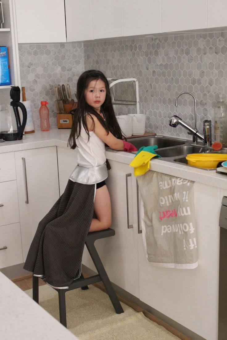 Arddun washing dishes in full princess costume
