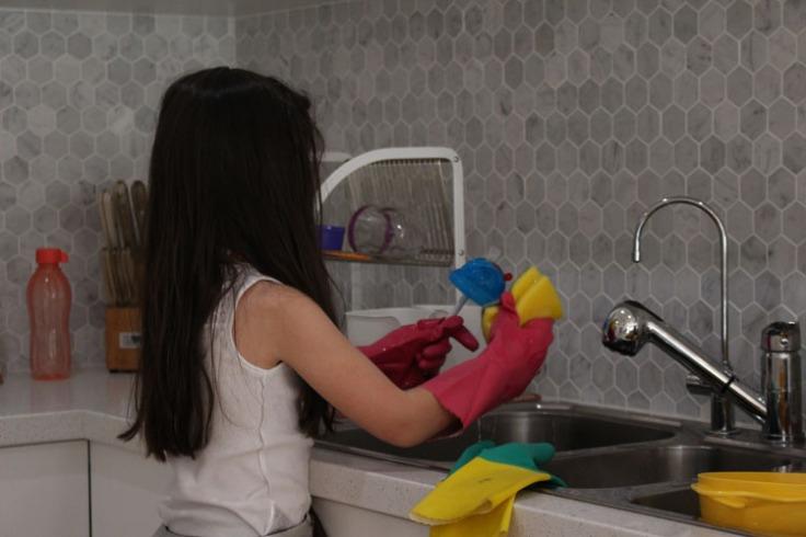Arddun washing dishes at sink