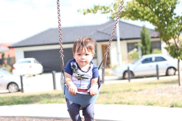 Atticus in swing looking sleepy